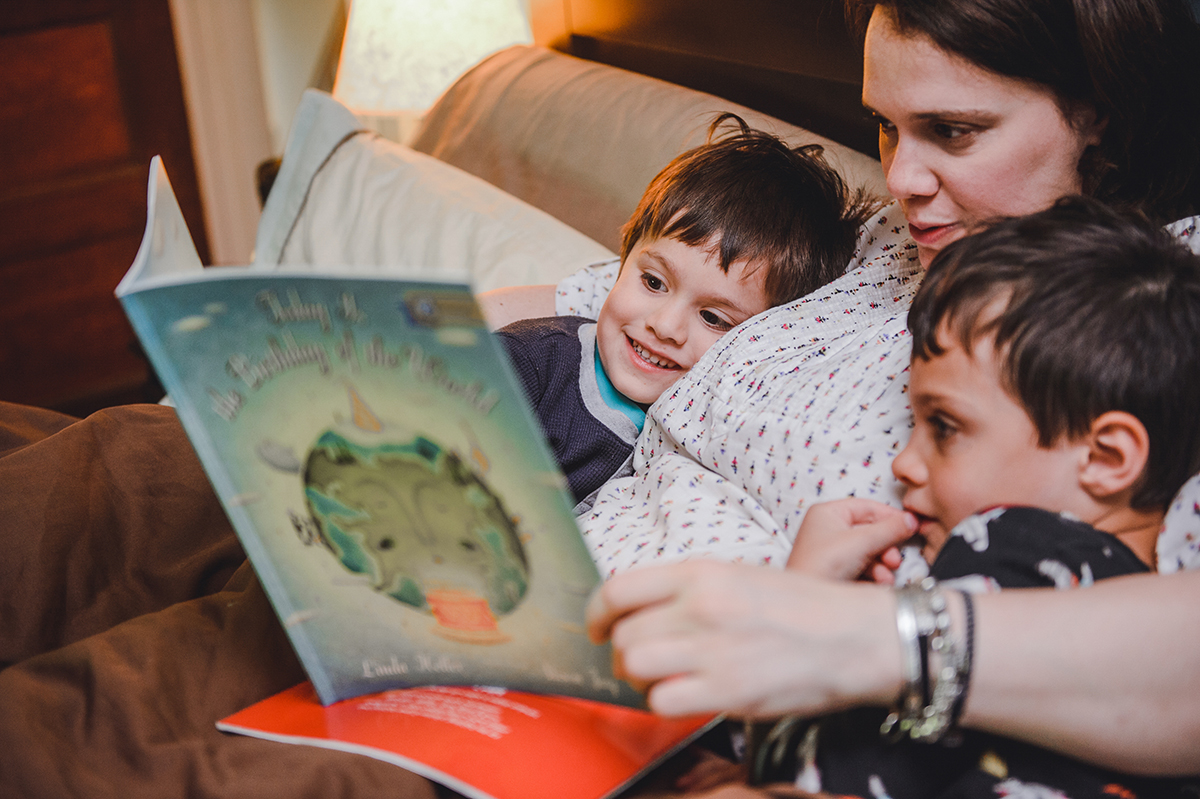 A mother reads to her children